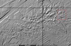 A black and white lidar visualisation of a complex of irregular earthwork mounds and ditches.