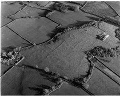 A black and white aerial photograph of prehistoric field boundary bank earthworks.