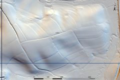 A black and white lidar visualisation of curvilinear earthwork lynchets on the north, east and south sides of a hill.