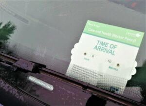 a parking permit inside a car windscreen