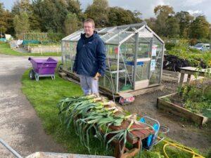 Oliver in the garden preparing vegitables for the market.