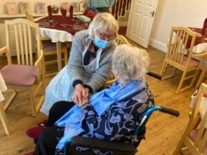 Two ladies ona care home sitting next to each other