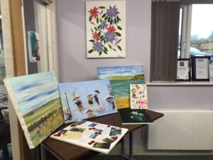 A selection of paintings on a table.