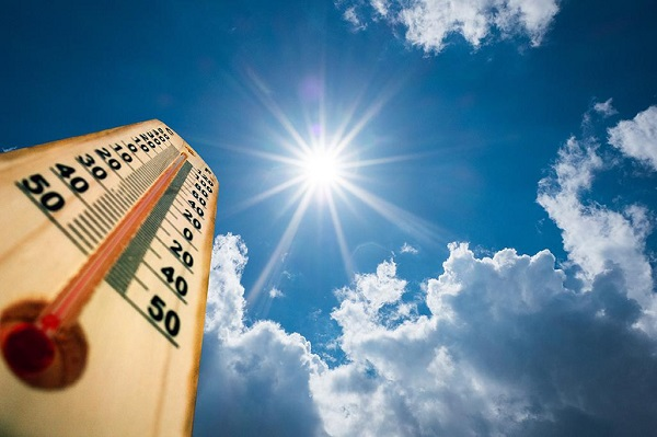 Thermometer and blue sky with sun shining