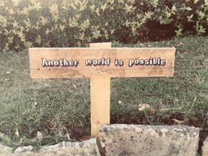 """Sign in the ground which reads """"Another World is possible"""""""