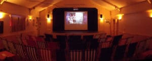Croyde Deckchair cinema screen and chairs in foreground
