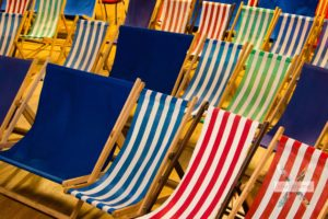 Close up of multi-coloured deck chairs