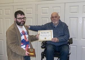 C with an award he won