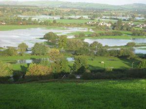 Photo showing flooding across fields in Devon