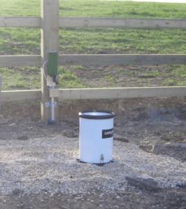 Hydro Logic rain gauge and transponder in a field