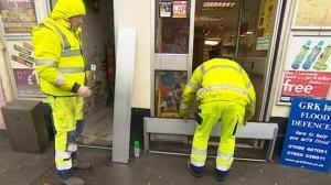 Photo of flood wardens installing PFR
