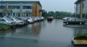 Photo showing flooding in car park