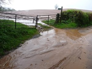 Photo showing Surface-water runoff causing mud on roads and localised flooding