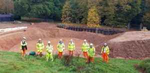 socially distanced team visit to site in front of the underground storage area and future amphitheatre