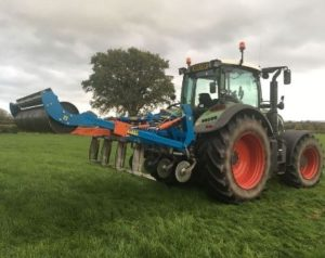 A tractor undertaking tackling soil compaction methods