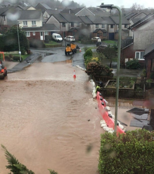 An image of a flooded road in Ivybridge, Devon, as a result of storms in 2020.