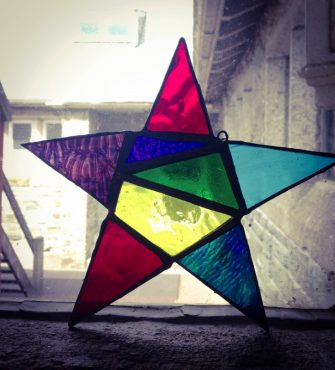 Image of star in multi-coloured stained glass