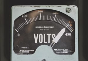 Close-up of the dial of an electricity meter, with 'volts' written on it