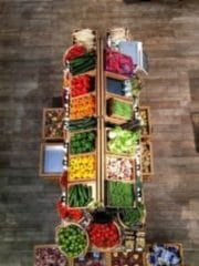 Aerial view of fruit and vegetables in crates, part of market stall display