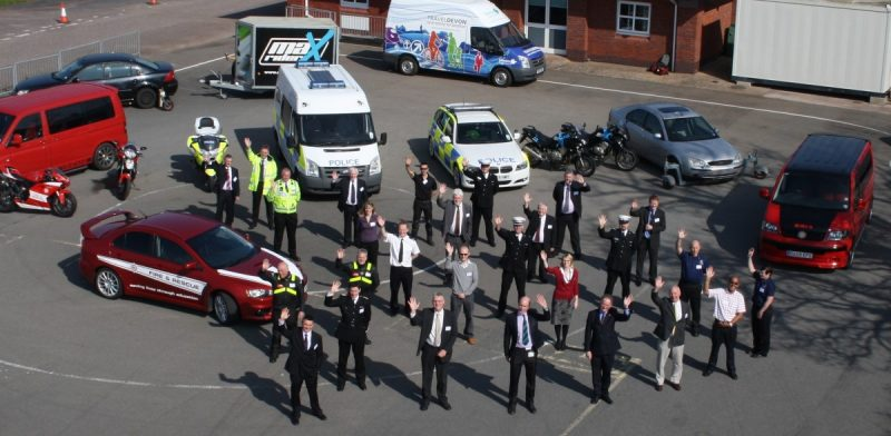 Photo of people waving who are a partnership of public, private and third sector organisations who work together for road safety.