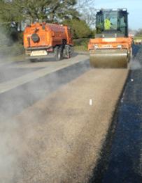 Road roller preparing for resurfacing work