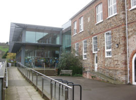 photo of the mansion totnes,modern building with large glass windows and a hand rail and path for ease of access
