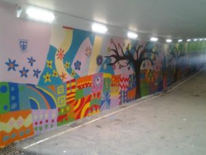 brightly colours mural in a subway