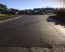 estate road, shepherds meadow on summers day at