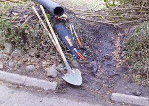 side of road, with tools and a drrainage pipe