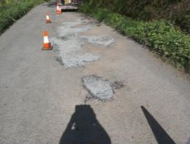 surface dressing of road at Sheepwash with traffic cones