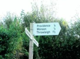 White road sign in the countryside