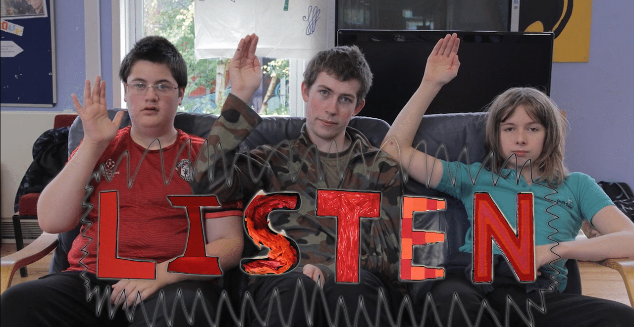 three young people on a sofa with the word listen underneath them