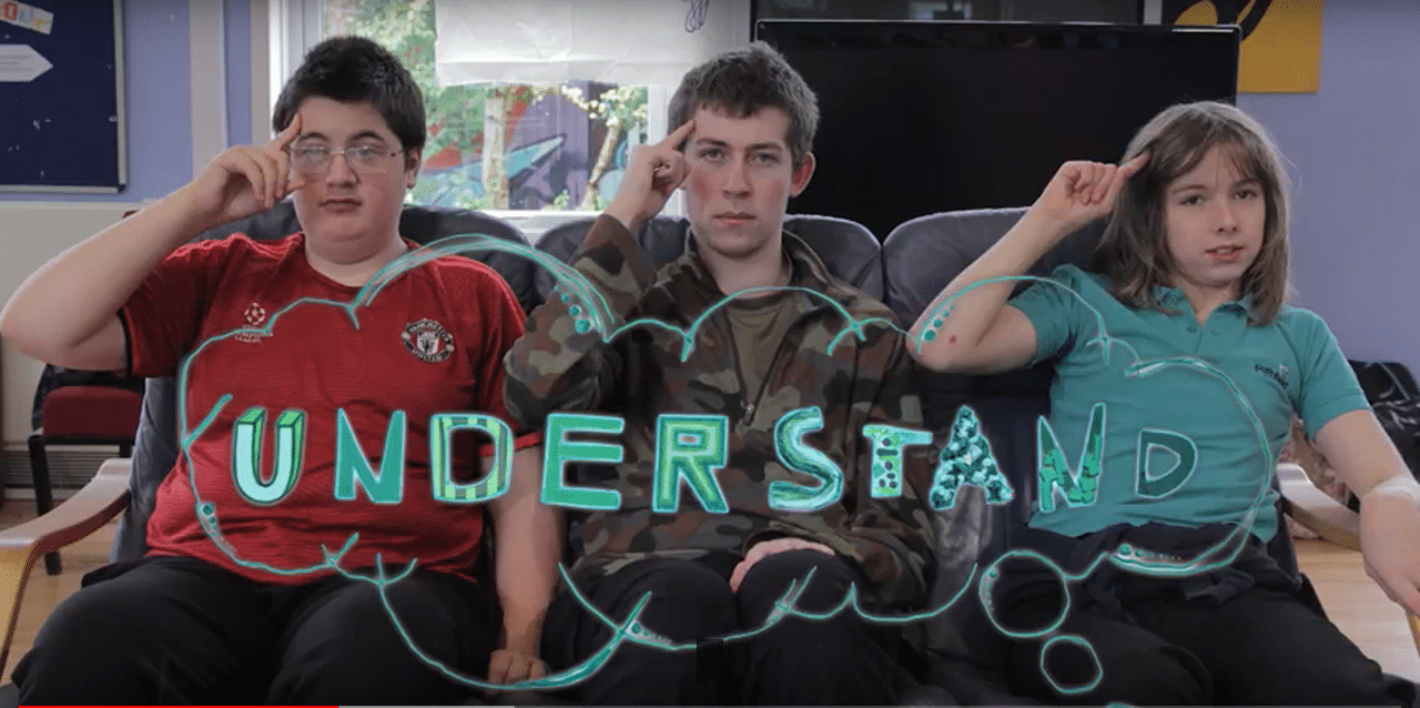 three young people sitting on a sofa with understand underneath them