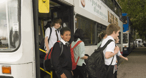 teenage boys getting of a bus