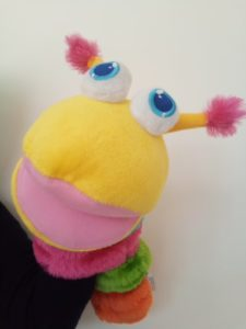 tactile soft toy caterpillar who greets children and lets them know when session has finished